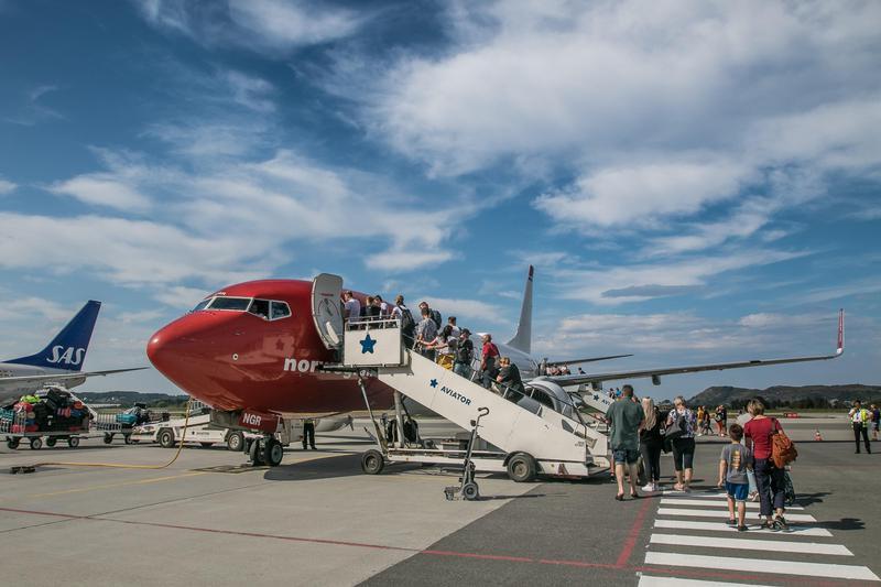 Passengers boarding an Norwegian airplane