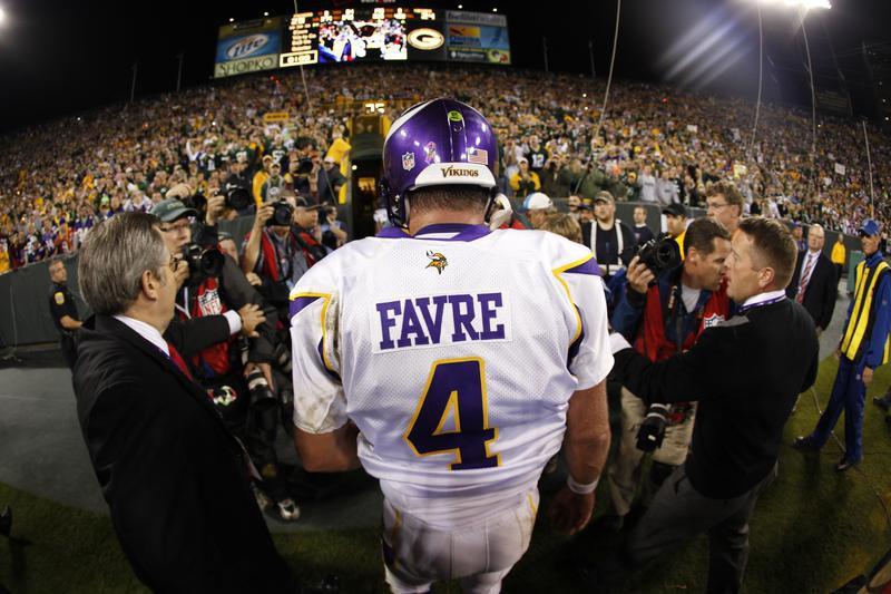 Brett Favre walks off the field at Lambeau Field