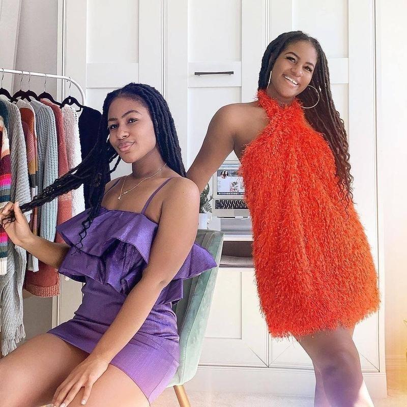 Girls in dresses poses in room