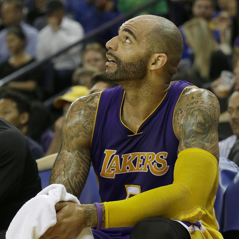 Carlos Boozer sits on bench and looks out