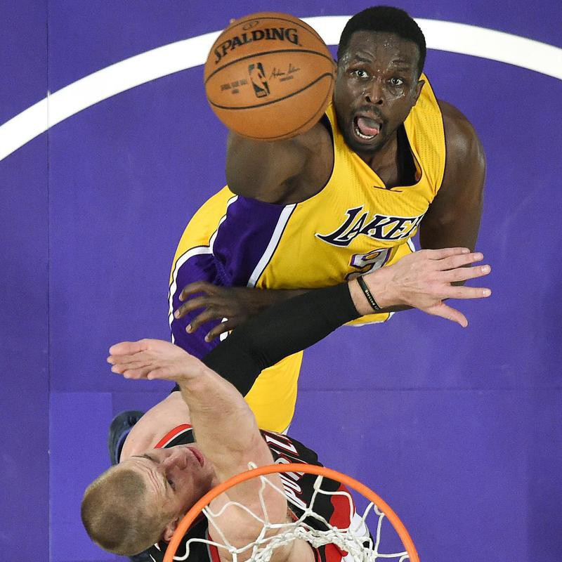 Los Angeles Lakers forward Luol Deng shoots