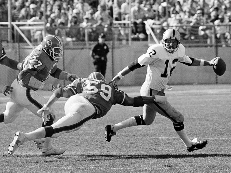 Lyle Alzado of the Denver Broncos pursues Kenny Stabler of the Oakland Raiders