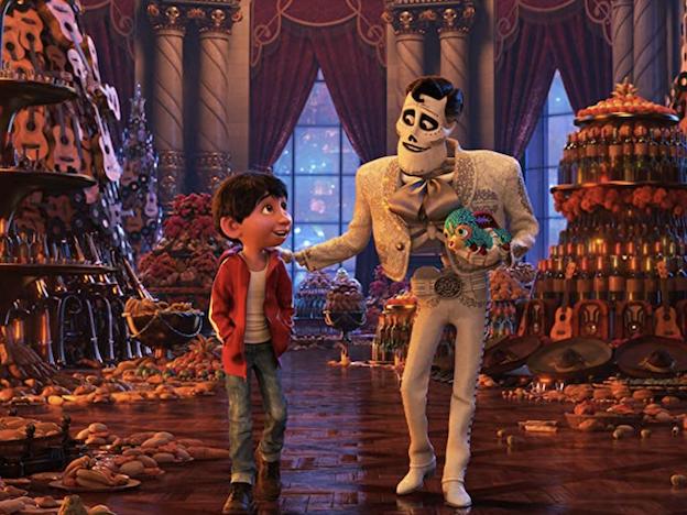 Ernesto de la Cruz and Miguel in Coco