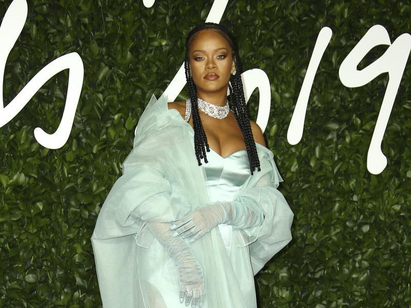 Rihanna poses at the British Fashion Awards