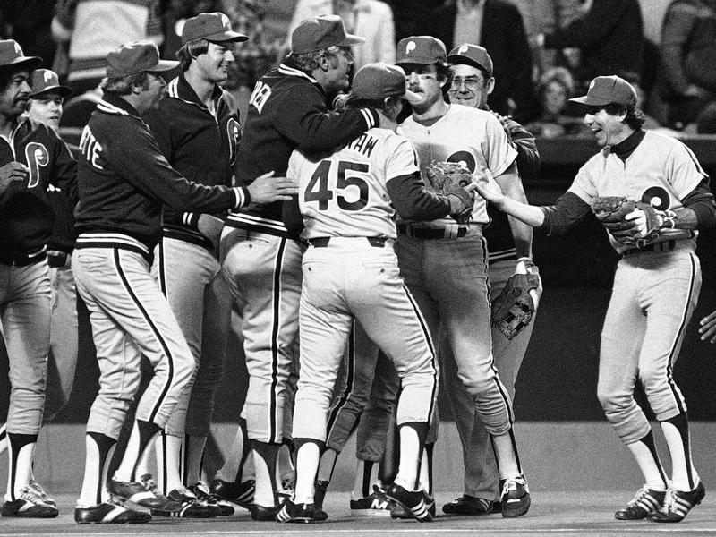 Dallas Green puts arm around Tug McGraw and Larry Bowa