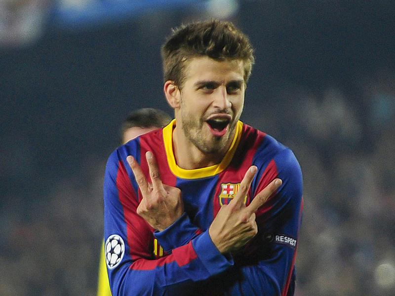 Barcelona's Gerard Pique reacts after scoring during a Champions League match.