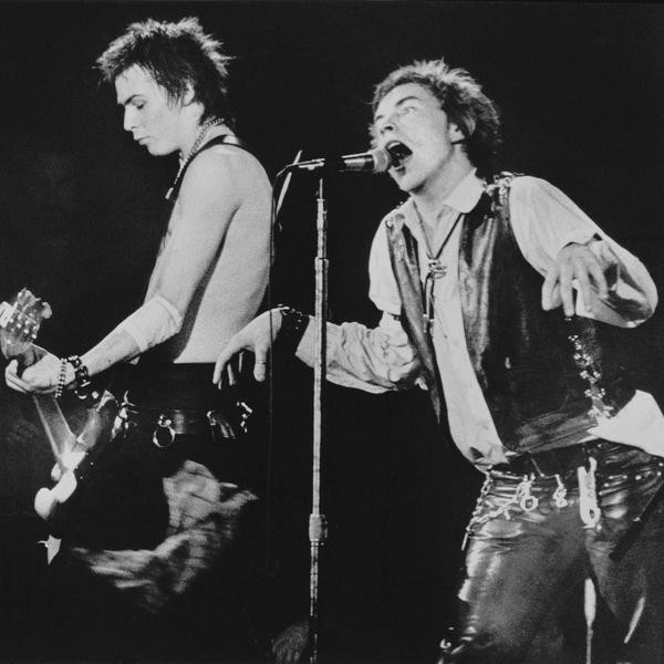 Sid Vicious, left, on bass guitar and frontman John Rotten of the Sex Pistols perform in front of a capacity crowd at San Francisco's Winterland auditorium, Jan. 15, 1978.  This was the Pistols' last stop on their U.S. tour.  (AP Photo)