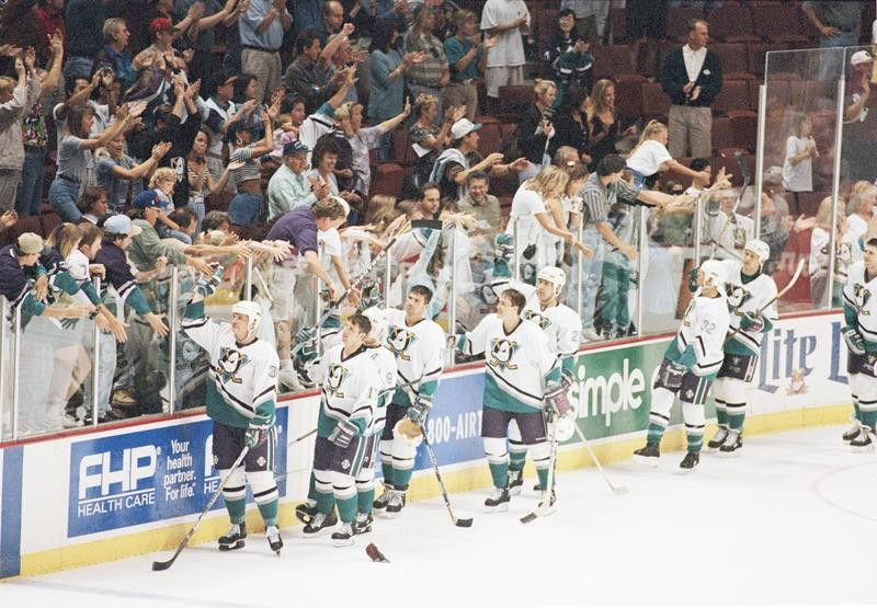 Anaheim Mighty Ducks players give high fives to fans