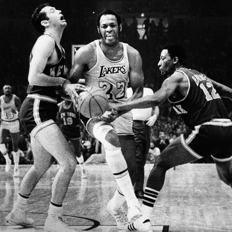Elgin Baylor maneuvers his way through New York Knicks