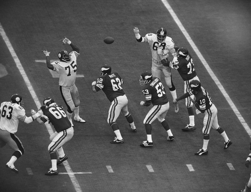 Joe Greene gets ready to block pass by Minnesota Vikings quarterback Fran Tarkenton