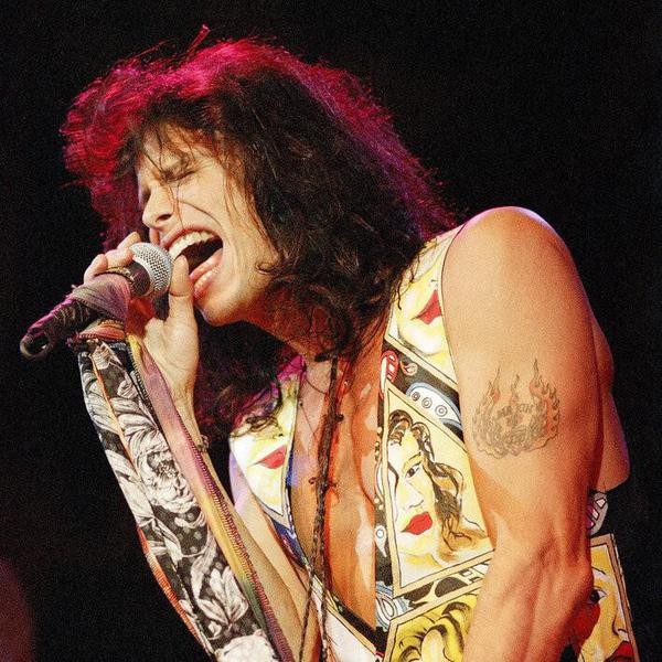 Steven Tyler, lead singer for the rock group Aerosmith, belts out vocals during a concert at the House of Blues in West Hollywood, California on April 22, 1994, as part of special opening week events for the nightclub. House of Blues, owned by Hard Rock Caf founder Issac Tigrett and actor Dan Aykroyd, who appeared as Elwood Blues in The Blues Brothers, will open to the public on May 3. (AP Photo/Michael Caulfield)