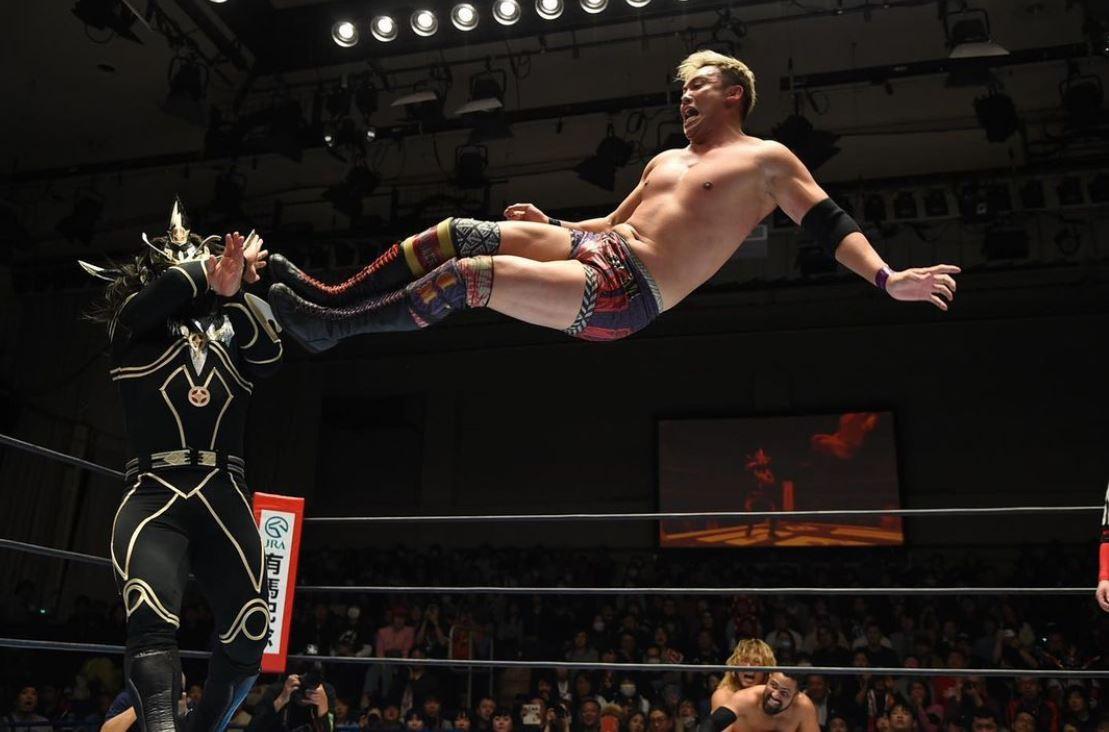 Okada giving a drop kick