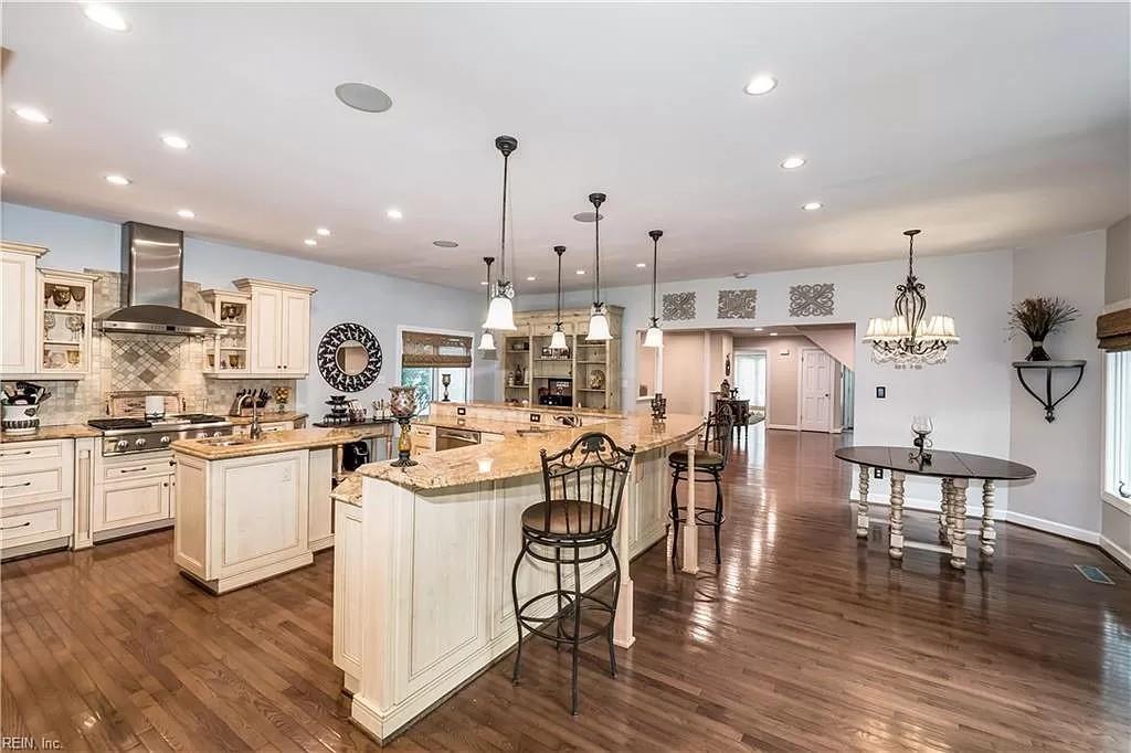 Large open floor plan kitchen with recessed lighting
