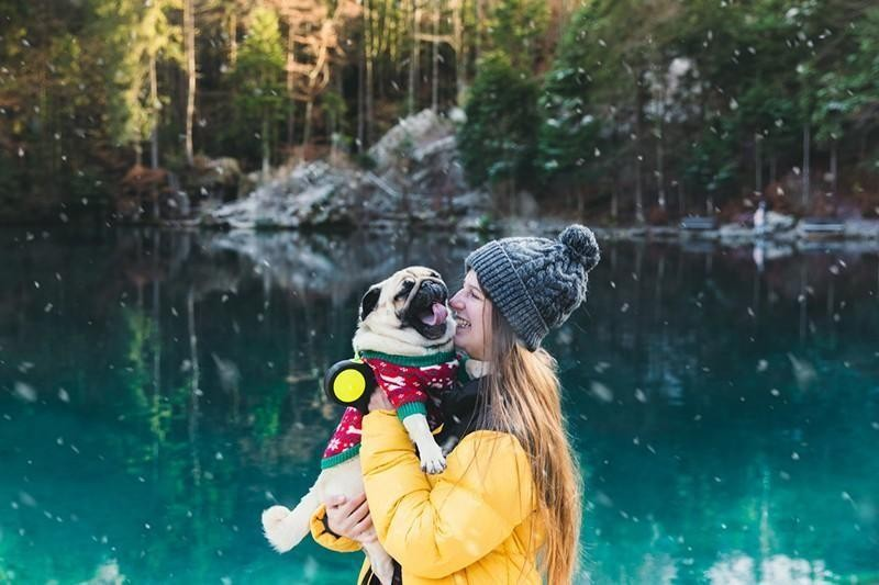 happy woman with pug