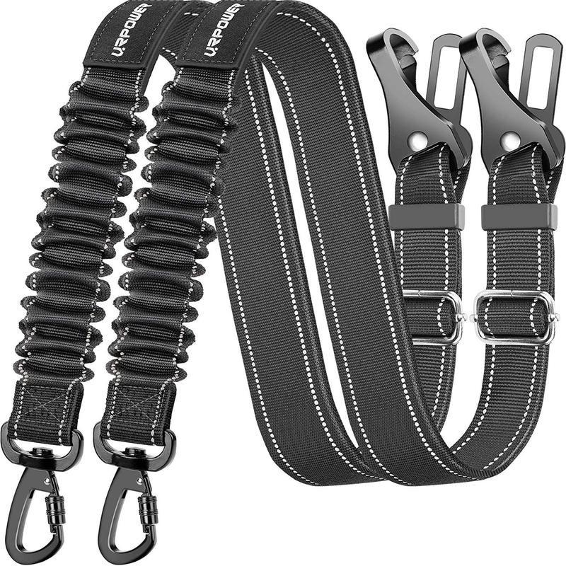 Two black dog car seat belts