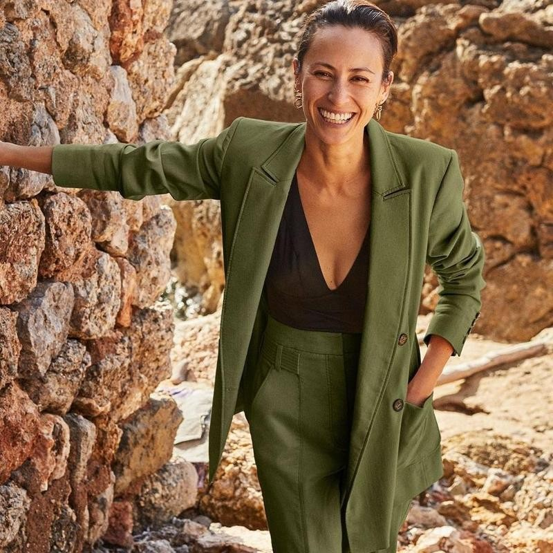 Woman smiling in green suit