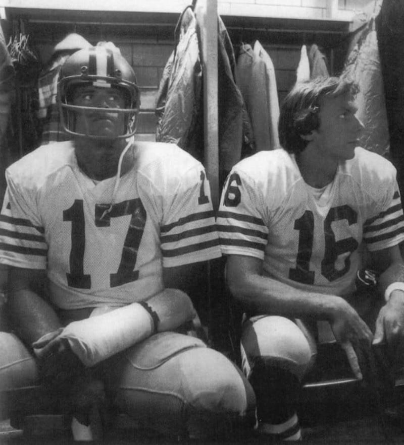 Steve DeBerg sitting in locker room with Joe Montana
