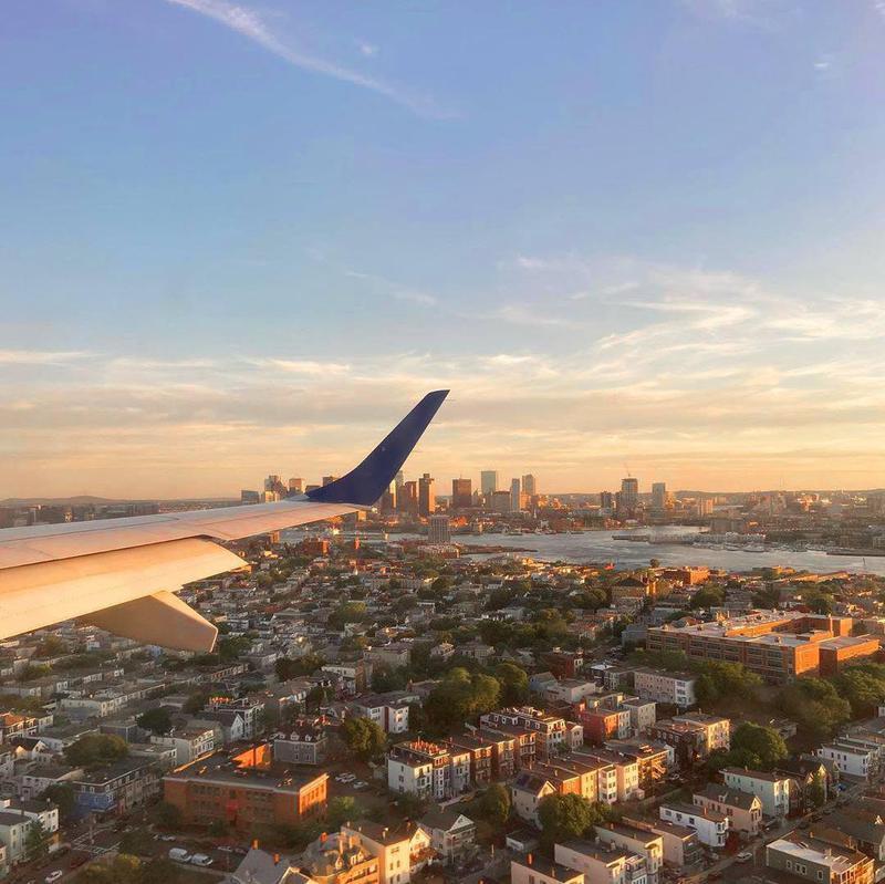 JetBlue airplane flying over Boston