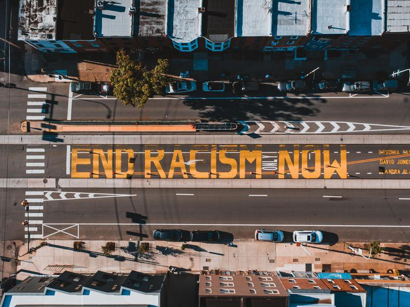 End racism now sign