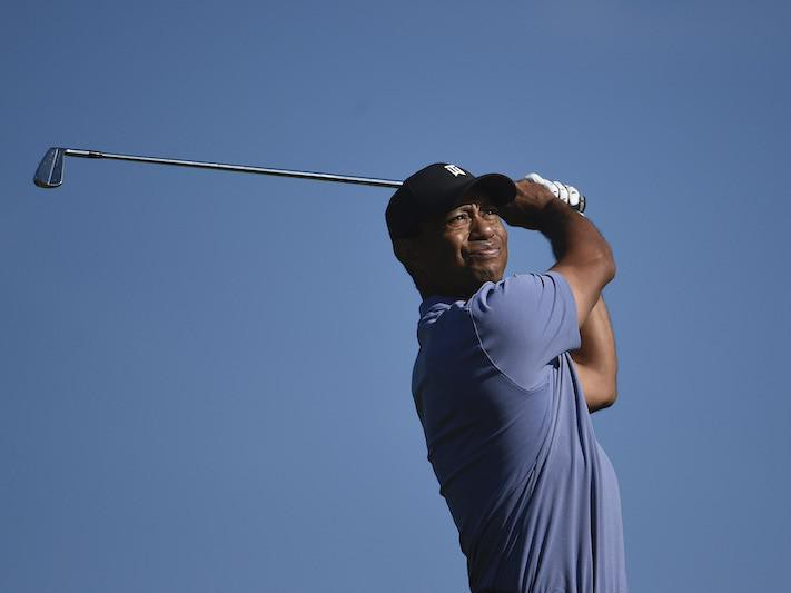 Tiger Woods hits hit tee shot