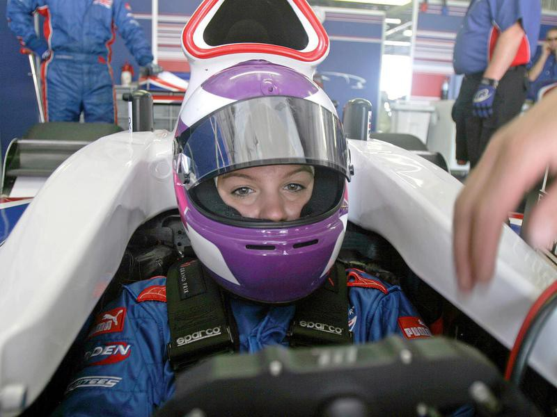 Katherine Legge sits in car