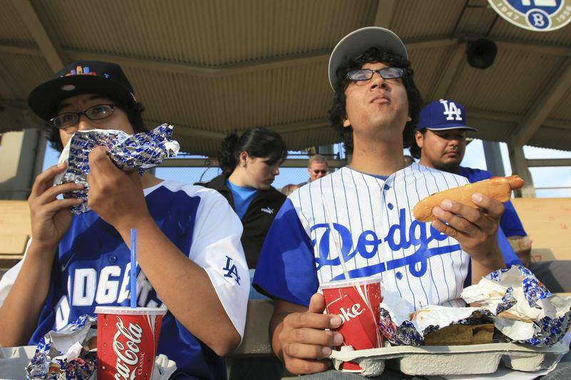 Fans eat hot dogs