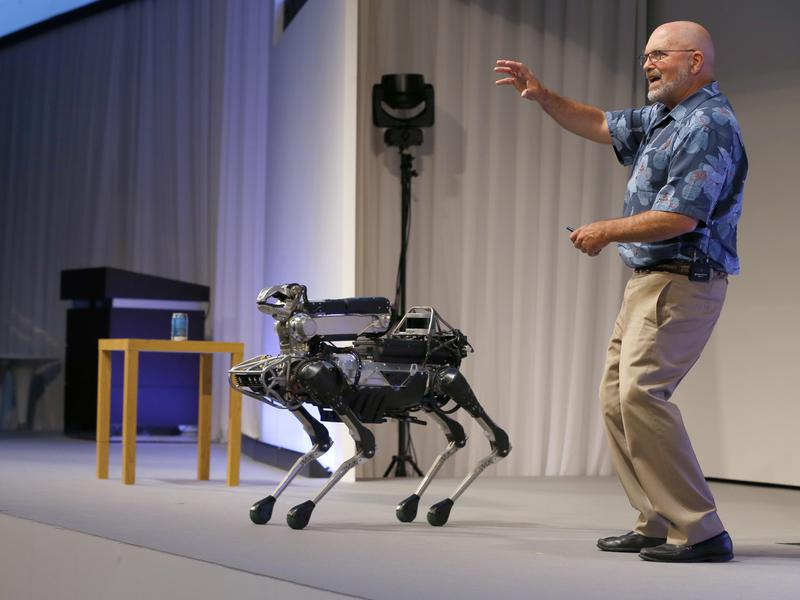 Boston Dynamics CEO Marc Raibert speaks about his four-legged robot SpotMini during a presentation in Tokyo in 2017.
