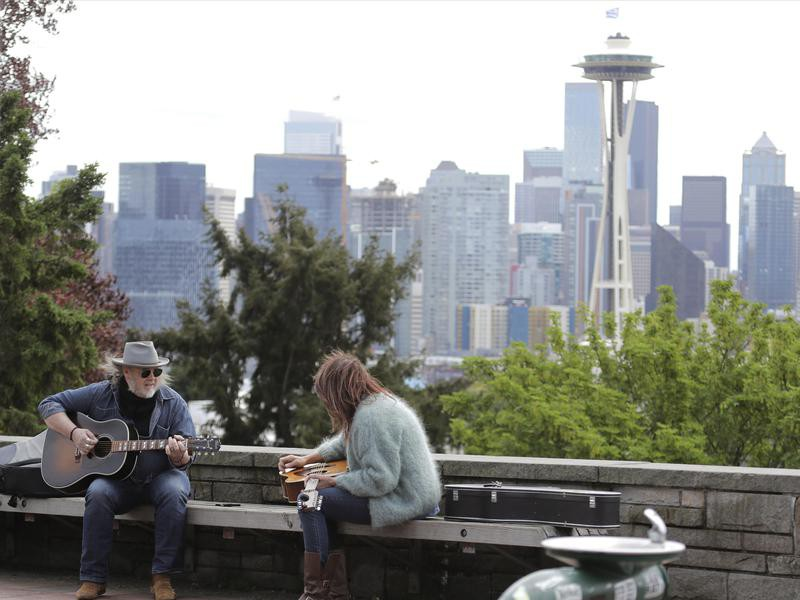 People sitting at Kerry Park