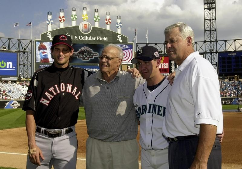 Aaron Boone and Bret Boone pose with grandfather Ray and father Bob before MLB All-Star Game