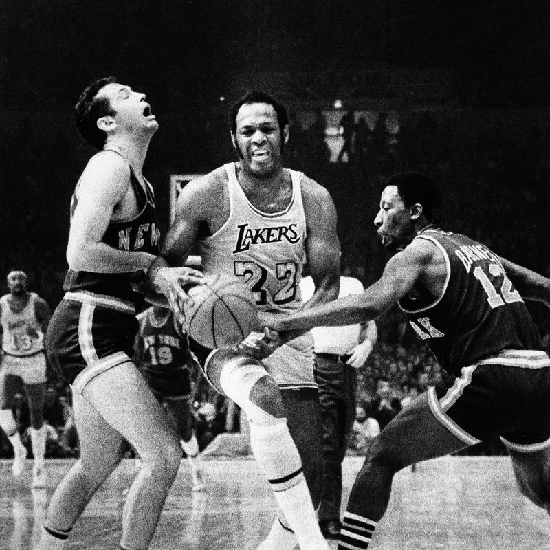 Los Angeles Lakers' Elgin Baylor maneuvers his way through New York Knicks' Bill Bradley
