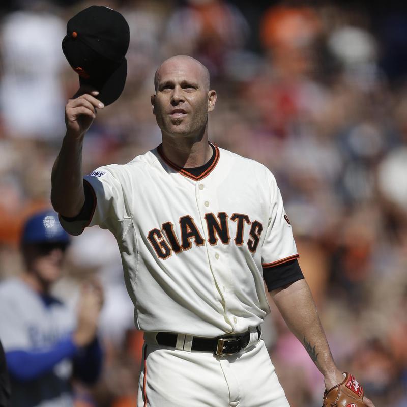 San Francisco Giants pitcher Tim Hudson waves to fans
