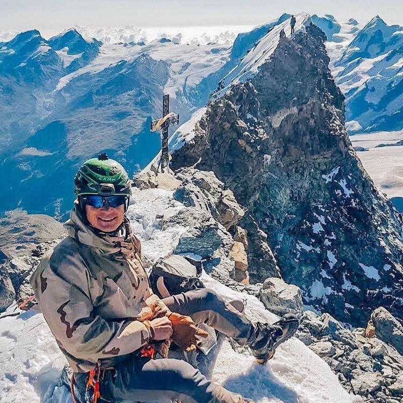 Climber on top of the Matterhorn, Switzerland