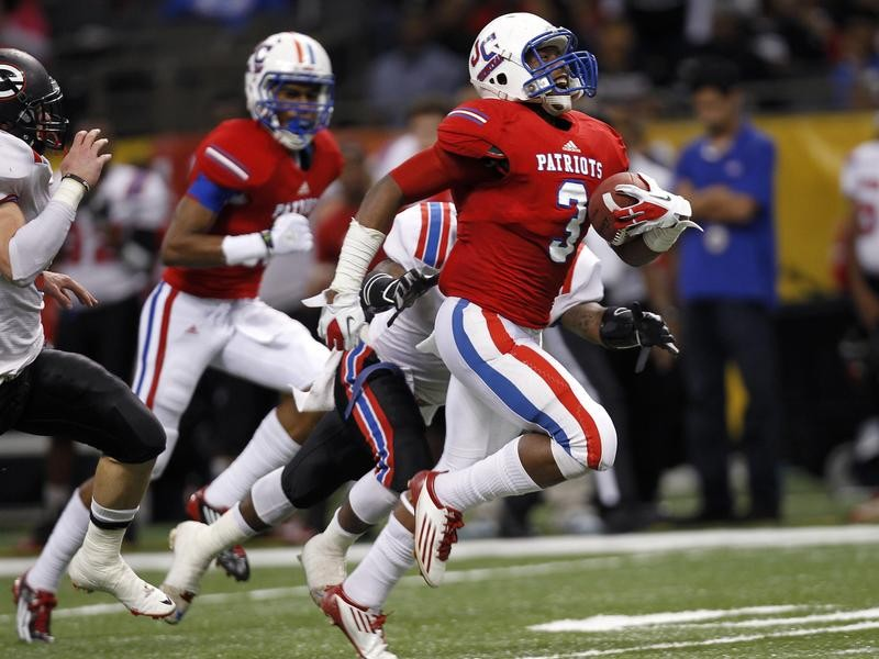 John Curtis Christian School's George Moreira runs for a touchdown