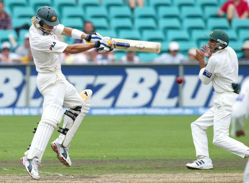Shane Watson hits ball towards Yasir Hameed