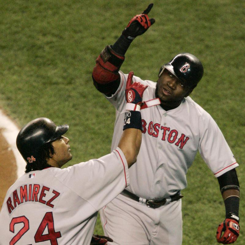 David Ortiz and Manny Ramirez react after Ortiz hit a two-run home run