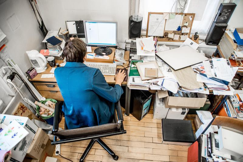 Woman working at messy desk
