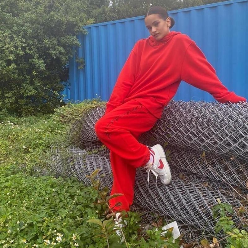Woman posing in red sweats