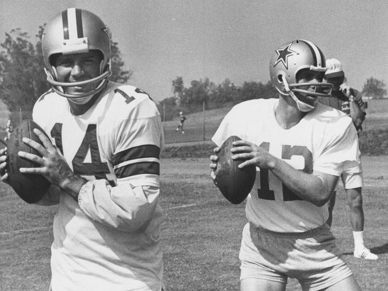 Craig Morton and Roger Staubach loosen up their throwing arms