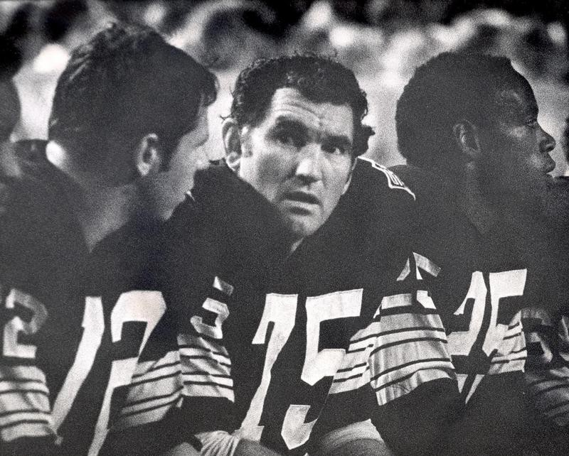 Forrest Gregg sits on bench with Green Bay Packers teammates