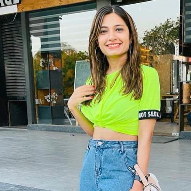 Woman wearing neon green crop top