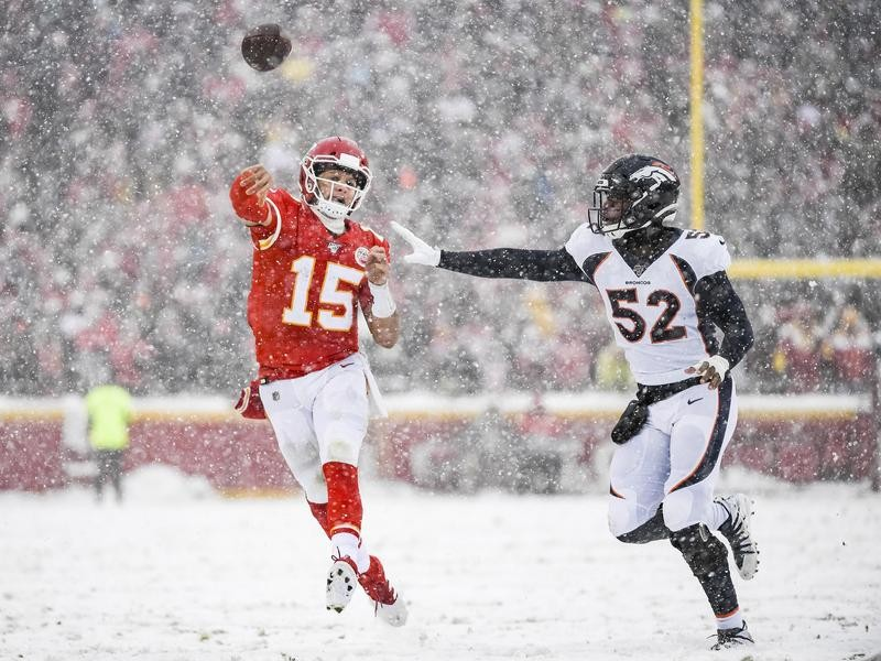 Patrick Mahomes throws in the snow against the Denver Broncos