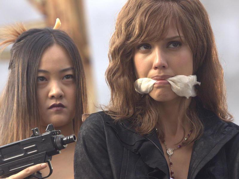 Jessica Alba and Cheryl Chin in Machete (2010)