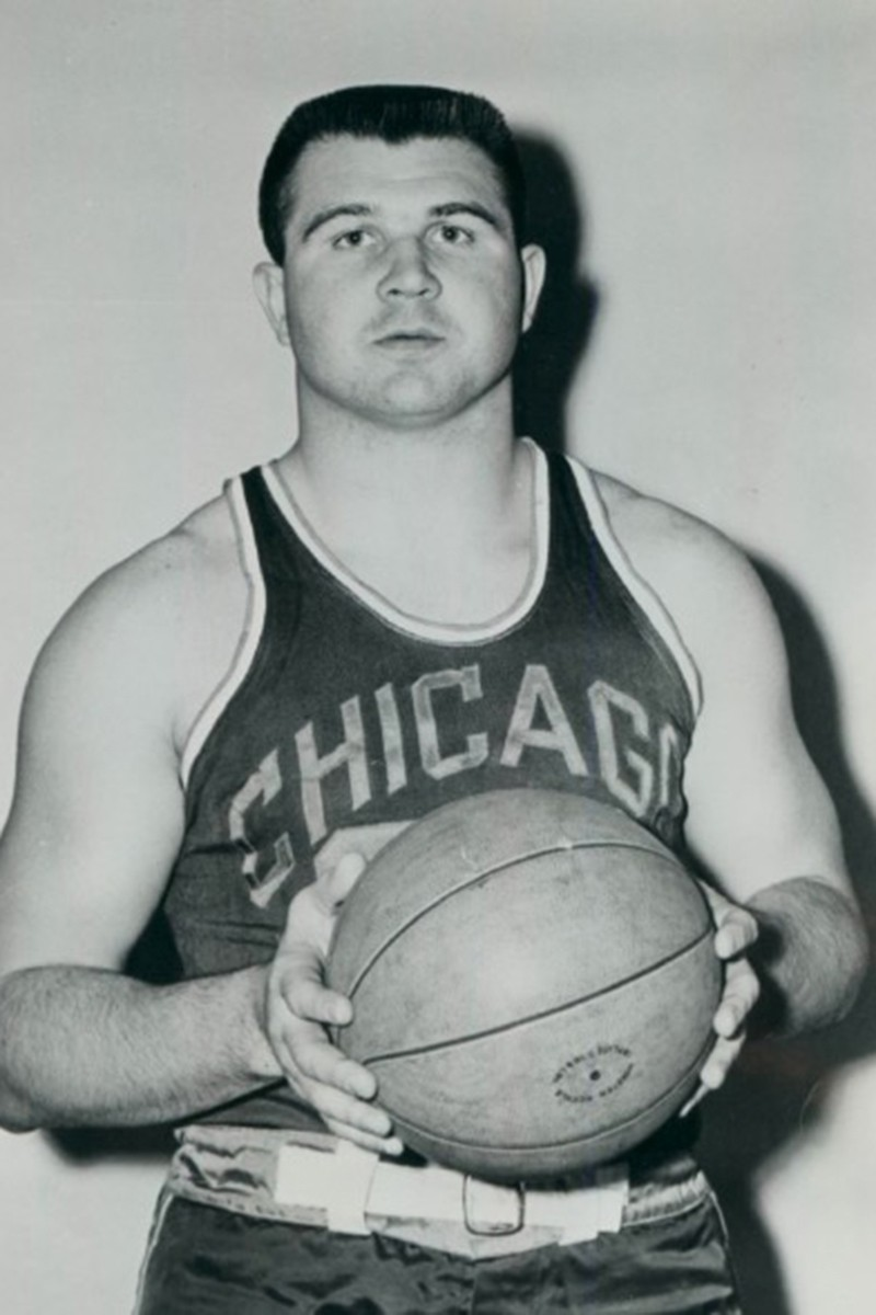 Mike Ditka  holding a basketball