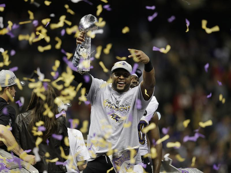 Ray Lewis celebrates with the Vince Lombardi trophy