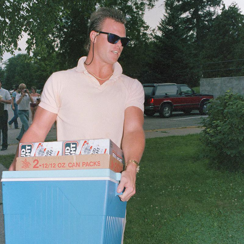 Jim McMahon of the Chicago Bears carries cooler