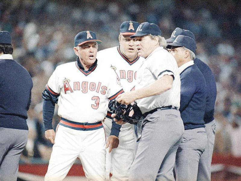 Gene Mauch argues with home plate umpire Terry Cooney