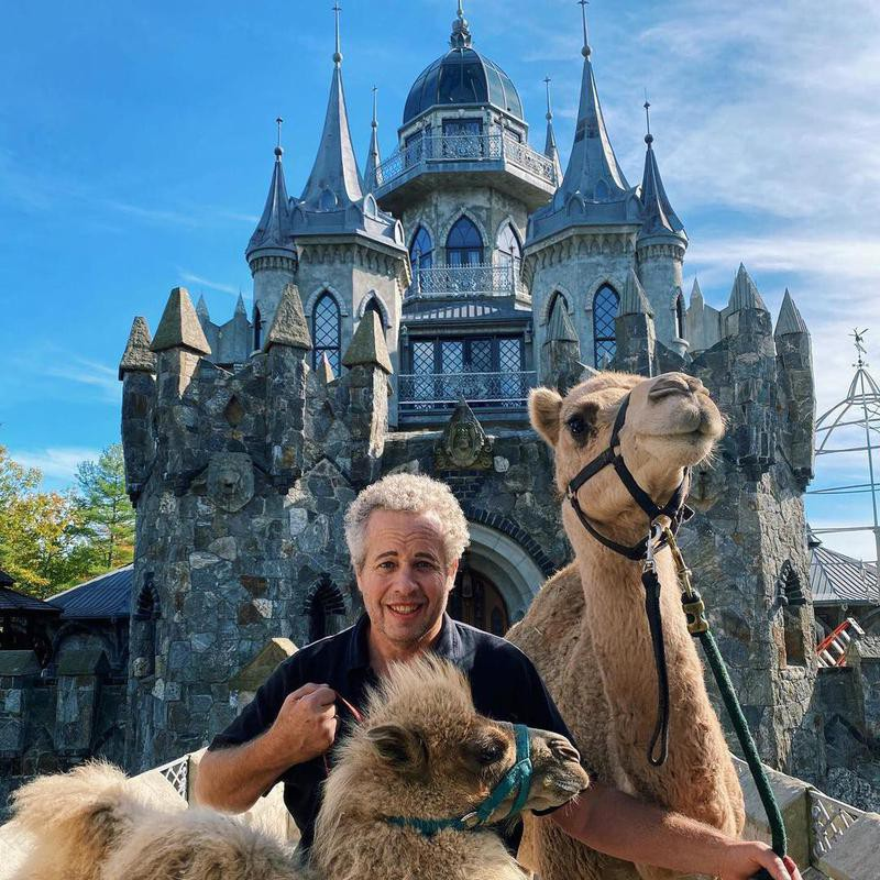 Chris Mark with his camels in his castle