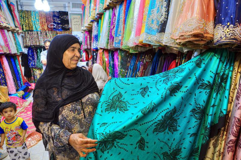 Iranian woman at a textile shop