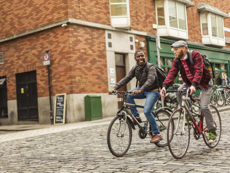 Men biking in Ireland