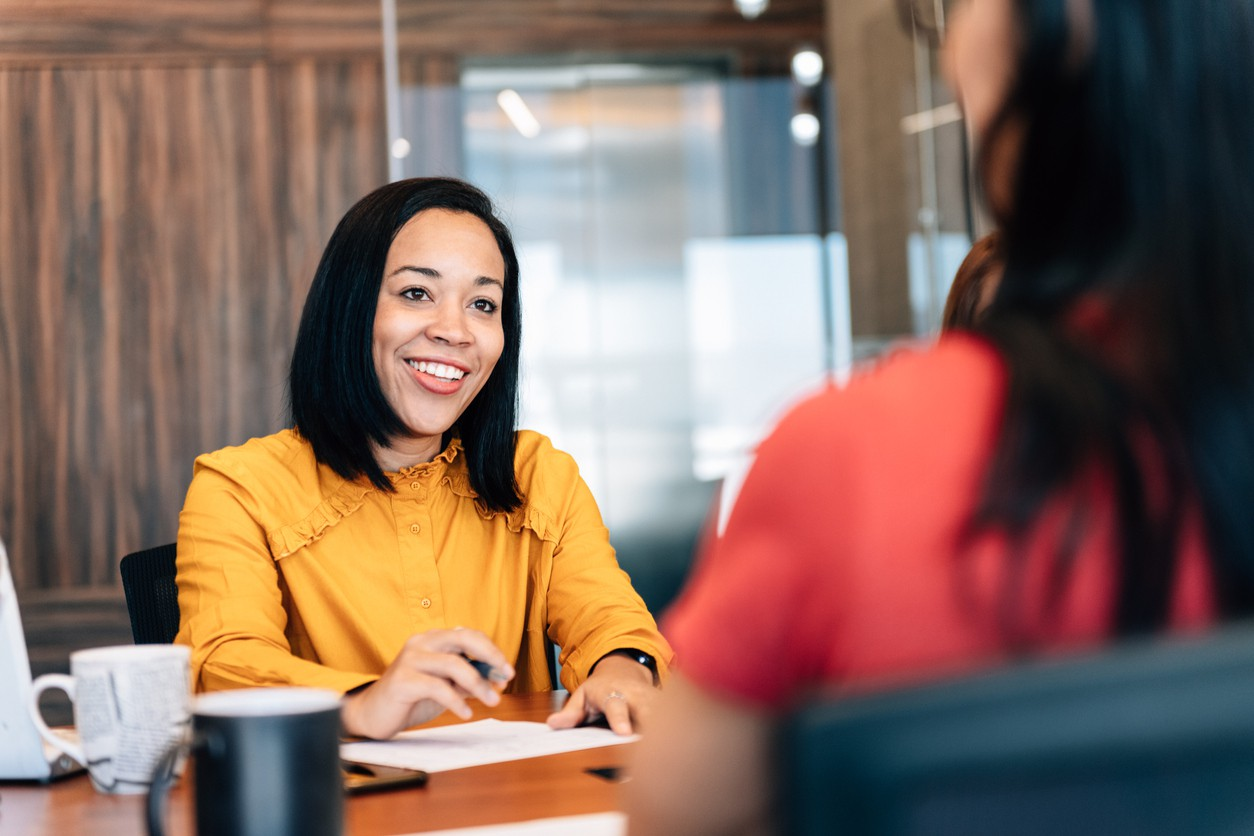 Woman talking at a desk
